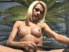 Enticing femboy beauty rubs girl pole