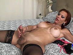 Redhead shemale in black stockings jerking off