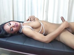 Asian hottie playing on a medical gurney
