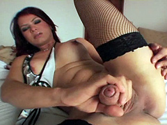 Busty shemale in black stocking stroking