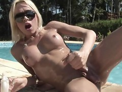 Tranny babe strips outdoors by pool