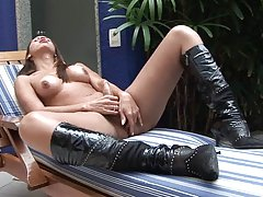 Exotic shemale babe in leather boots strokes