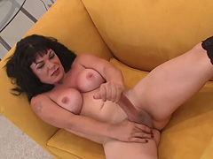 Brunette shemale in black stockings playing her big cock
