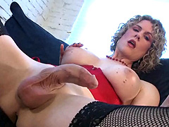 Curly shemale with big tits stroking