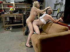 Blonde shemale fucking guy in a garage