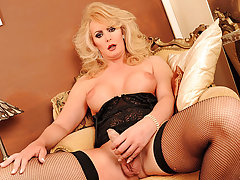 Sexy Alison Dale strokes her uncut cock