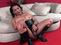 TS babe in black leather boots jerk off