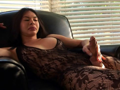 Horny asian shemale stroking her cock