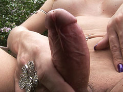 Close up of a thick shemale cock squirting