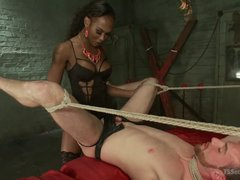 Ebony TS Kayla Biggs fucks tied slave