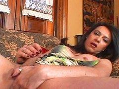 Hot dark hair tranny masturbating on the couch till it cums!
