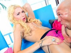 Bald guy and blonde tranny in oral action