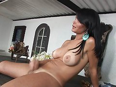 Nasty brunette uses a table for stroking